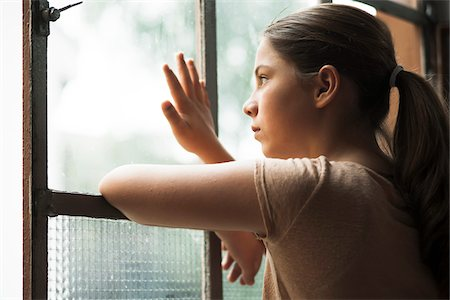 preteen touch - Girl looking out of window, Germany Stock Photo - Premium Royalty-Free, Code: 600-06899909