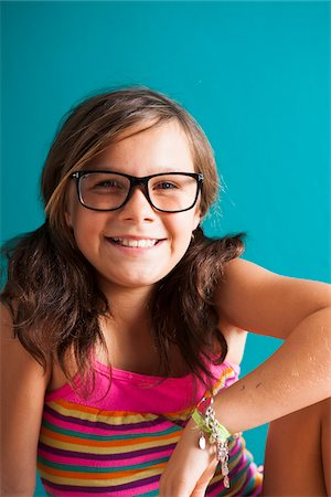 preteen girl pigtails - Portrait of girl wearing eyeglasses, smiling at camera, Germany Stock Photo - Premium Royalty-Free, Code: 600-06899914