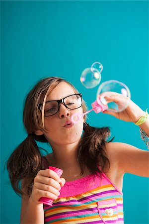 Girl blowing bubbles, Germany Stock Photo - Premium Royalty-Free, Code: 600-06899916