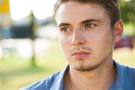 portrait looking away - Close-up portrait of young man outdoors, Germany Stock Photo - Premium Royalty-Free, Code: 600-06899928