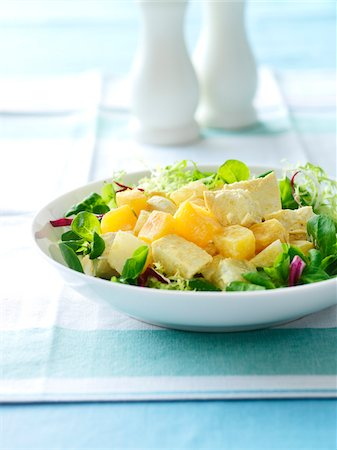 Mixed Baby Salad Greens topped with Chicken and Fruit, Studio Shot Stock Photo - Premium Royalty-Free, Code: 600-06892685