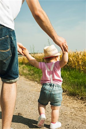 Father and Baby Daughter Walking Outdoors, Mannheim, Baden-Wurttemberg, Germany Stock Photo - Premium Royalty-Free, Code: 600-06892779