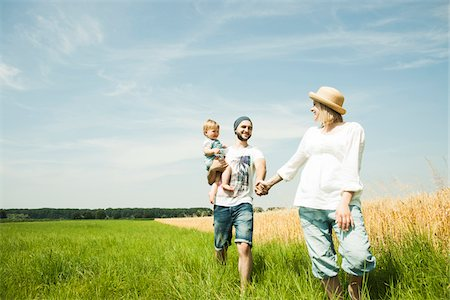 Family Walking by Agricultural Field, Mannheim, Baden-Wurttemberg, Germany Stock Photo - Premium Royalty-Free, Code: 600-06892773