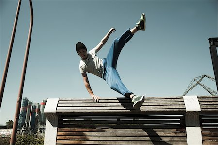 sports - Teenaged boy jumping over barrier, freerunning, Germany Stock Photo - Premium Royalty-Free, Code: 600-06900016