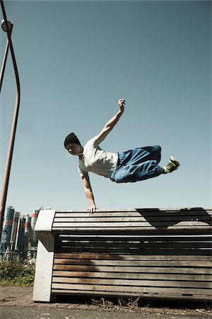 Teenaged boy jumping over barrier, freerunning, Germany Stock Photo - Premium Royalty-Free, Code: 600-06900017