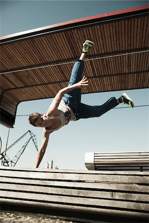 Teenaged boy doing handstand on barrier, freerunning, Germany Stock Photo - Premium Royalty-Free, Code: 600-06900013