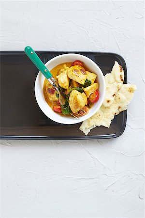 Overhead View of Chicken Curry with Naan Bread, Studio Shot Stock Photo - Premium Royalty-Free, Code: 600-06934973