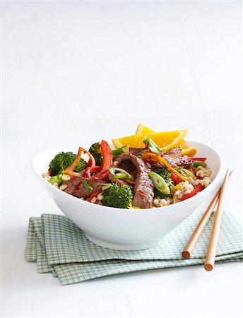 Healthy Beef, Broccoli and Orange Stir Fry with Barley, Studio Shot Stock Photo - Premium Royalty-Free, Code: 600-06934989