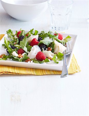 food - Fish Salad with Berries, Goat Cheese, Pecans and Arugula, Studio Shot Stock Photo - Premium Royalty-Free, Code: 600-06934991
