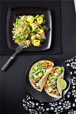 fork - Overhead View of Quinoa with Zucchini, Asparagus and Tofu and Tacos with Bean Mix and Avocado, Studio Shot Stock Photo - Premium Royalty-Free, Code: 600-06935019