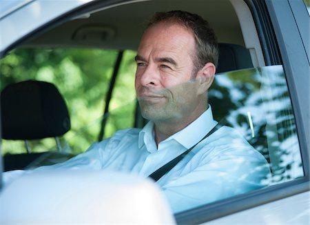 Businessman Driving Car, Mannheim, Baden-Wurttemberg, Germany Stock Photo - Premium Royalty-Free, Code: 600-06939748