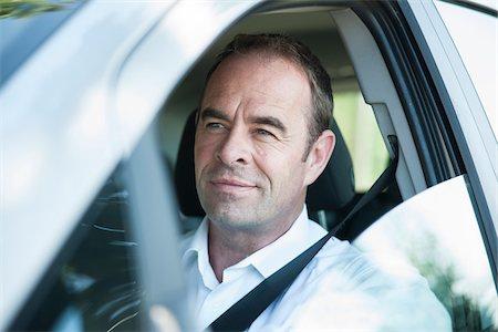 Businessman Driving Car, Mannheim, Baden-Wurttemberg, Germany Stock Photo - Premium Royalty-Free, Code: 600-06939750