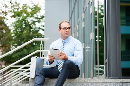 Businessman using Tablet Computer Outdoors, Mannheim, Baden-Wurttemberg, Germany Stock Photo - Premium Royalty-Free, Code: 600-06939764
