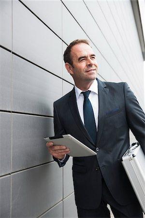 Portrait of Businessman using Tablet Computer, Mannheim, Baden-Wurttemberg, Germany Stock Photo - Premium Royalty-Free, Code: 600-06939769