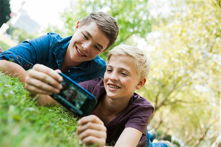 Boys taking Photo with Cell Phone Outdoors, Mannheim, Baden-Wurttemberg, Germany Stock Photo - Premium Royalty-Free, Code: 600-06939776
