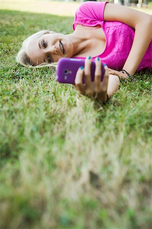Teenage Girl using Cell Phone Outdoors, Mannheim, Baden-Wurttemberg, Germany Stock Photo - Premium Royalty-Free, Code: 600-06939777