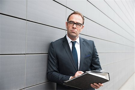 Portrait of Businessman using Tablet Computer Outdoors, Mannheim, Baden-Wurttemberg, Germany Stock Photo - Premium Royalty-Free, Code: 600-06939770