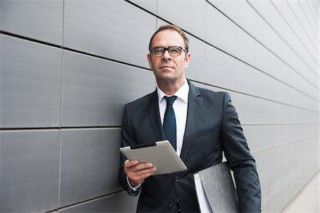 Portrait of Businessman using Tablet Computer Outdoors, Mannheim, Baden-Wurttemberg, Germany Stock Photo - Premium Royalty-Free, Code: 600-06939771