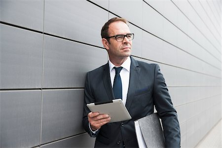 Portrait of Businessman using Tablet Computer Outdoors, Mannheim, Baden-Wurttemberg, Germany Stock Photo - Premium Royalty-Free, Code: 600-06939772
