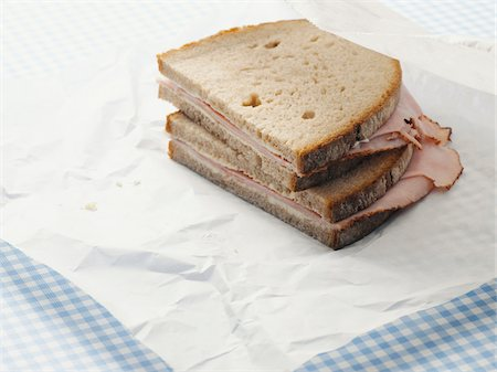 sandwich wrapper - Close-up of Ham Sandwich on Parchment Paper Stock Photo - Premium Royalty-Free, Code: 600-06967726