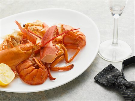 Plate with leftovers of Lobster and Bowtie, Studio Shot Stock Photo - Premium Royalty-Free, Code: 600-06967730
