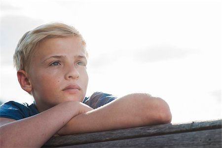 Close-up portrait of boy outdoors, looking into the distance, Germany Stock Photo - Premium Royalty-Free, Code: 600-06961048