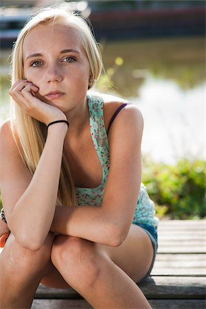 Portrait of teenage girl outdoors, looking at camera, Germany Stock Photo - Premium Royalty-Free, Code: 600-06961040