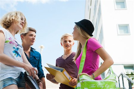 Group of teenagers standing outdoors talking, Germany Stock Photo - Premium Royalty-Free, Code: 600-06961060