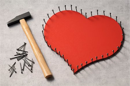restrained - Nails outlinging large, wooden heart and hammer Stock Photo - Premium Royalty-Free, Code: 600-06961804