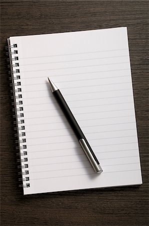 paper - Close-up of blank notebook and writing pen on wooden background Stock Photo - Premium Royalty-Free, Code: 600-06961800