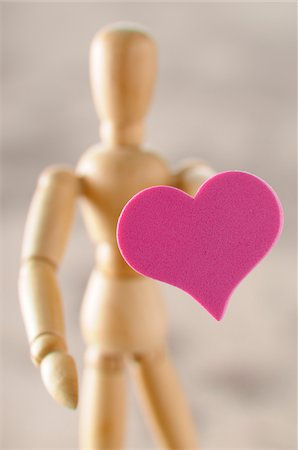 decoration - Wooden artist's mannequin holding heart Stock Photo - Premium Royalty-Free, Code: 600-06961802
