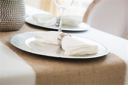 Elegant table setting at wedding event with plate charger and napkin Stock Photo - Premium Royalty-Free, Code: 600-06961850