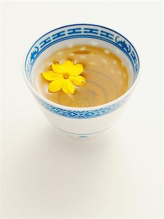 Chinese Cup of Jasmine Tea with Blossom, Studio Shot Stock Photo - Premium Royalty-Free, Code: 600-06961876
