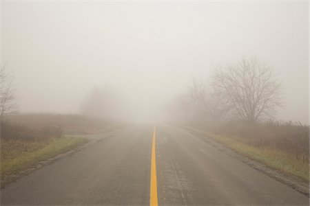 fog (weather) - Two Lane Highway in Fog, Town of Mount Albert, Ontario, Canada Stock Photo - Premium Royalty-Free, Code: 600-06962009
