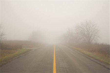 fog (weather) - Two Lane Highway in Fog, Town of Mount Albert, Ontario, Canada Stock Photo - Premium Royalty-Free, Code: 600-06962009