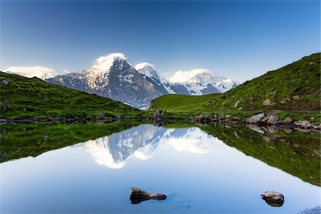 snow capped - Eiger, Monch and Jugnfrau Mountains reflecting in Alpine Lake, Bernese Alps, Canton of Bern, Switzerland Stock Photo - Premium Royalty-Free, Code: 600-07026602