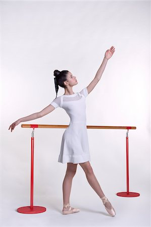 Young woman as ballet dancer, studio shot on white background Stock Photo - Premium Royalty-Free, Code: 600-07066928