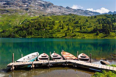 Rowing boats at dock, Alpine Lake Engstlensee, Switzerland Stock Photo - Premium Royalty-Free, Code: 600-07066994