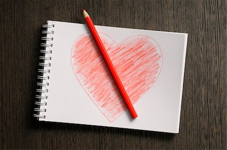 drawing - heart shaped drawing on notebook and colored pencil, wooden background, studio shot Stock Photo - Premium Royalty-Free, Code: 600-07067007