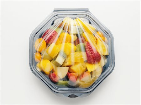 snack - Fruit salad packaged in plastic container, on white background, studio shot Stock Photo - Premium Royalty-Free, Code: 600-07067128