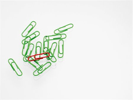 Green and red paper clips on white background, studio shot Stock Photo - Premium Royalty-Free, Code: 600-07067134