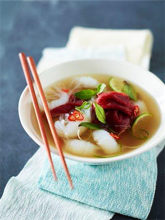 Bowl of Rare Beef Pho (Pho Tai) with Chopsticks, Studio Shot Stock Photo - Premium Royalty-Free, Code: 600-07067598