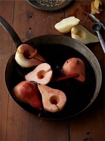 Poaching Bosc Pears in Red Wine, Studio Shot Stock Photo - Premium Royalty-Free, Code: 600-07067634