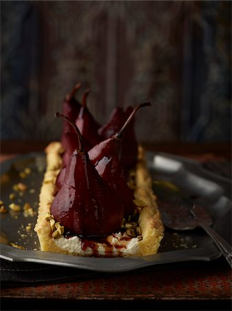 sweets - Poached Pear Tart, Studio Shot Stock Photo - Premium Royalty-Free, Code: 600-07067635
