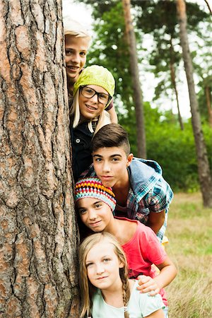 Portrait of group of children posing next to tree in park, Germany Stock Photo - Premium Royalty-Free, Code: 600-07117117