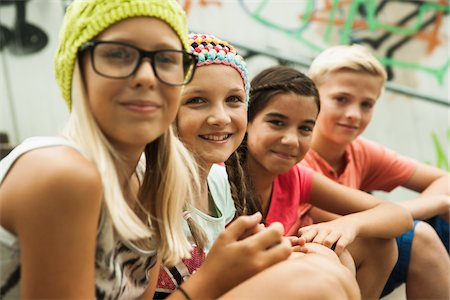 Close-up of group of children sitting on stairs outdoors, looking at camera, Germany Stock Photo - Premium Royalty-Free, Code: 600-07117158