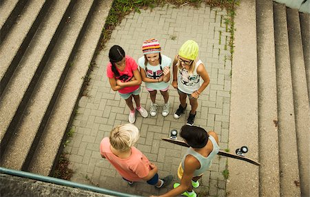 Overhead view of group of children standing on outdoor stairway, Germany Stock Photo - Premium Royalty-Free, Code: 600-07117164