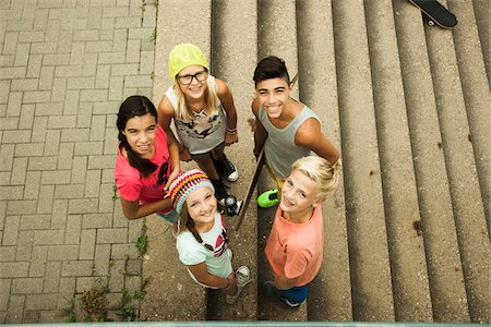 Group of children standing outdoors on cement staris, looking up at camera, Germany Stock Photo - Premium Royalty-Free, Code: 600-07117165
