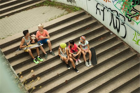 Overhead view of group of children sitting on stairs outdoors, Germany Stock Photo - Premium Royalty-Free, Code: 600-07117161
