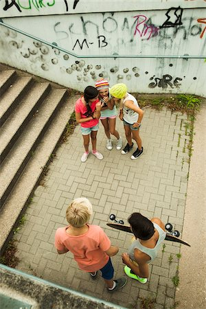 Overhead view of group of children standing on outdoor stairway, Germany Stock Photo - Premium Royalty-Free, Code: 600-07117163